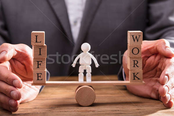 Businessperson Protecting Work And Life Balance Stock photo © AndreyPopov