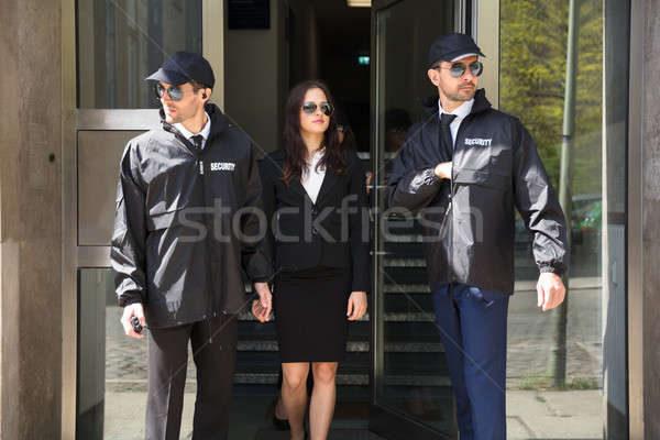Stock photo: Businesswoman Stepping Out From Office Building