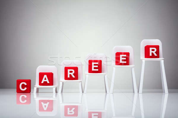 Red Cubic Blocks With Career Word On Increasing Chairs Stock photo © AndreyPopov