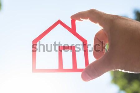 Mão humana casa modelo vermelho Foto stock © AndreyPopov