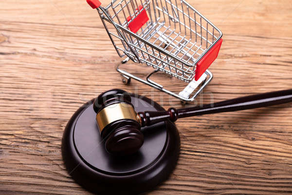 Judge Gavel And Shopping Cart On Table Stock photo © AndreyPopov
