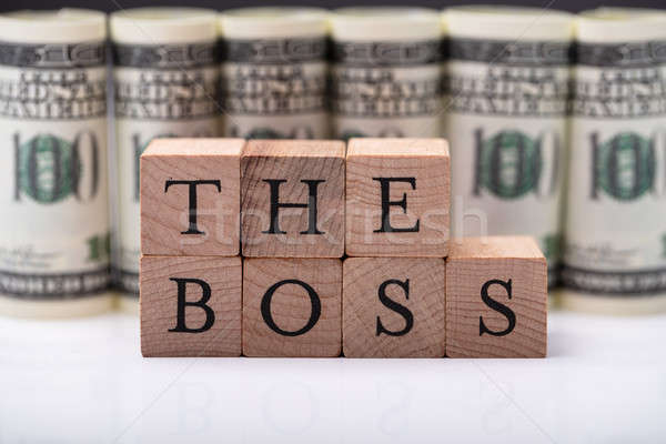 Wooden Blocks With The Boss Text In Front Of Banknotes Stock photo © AndreyPopov