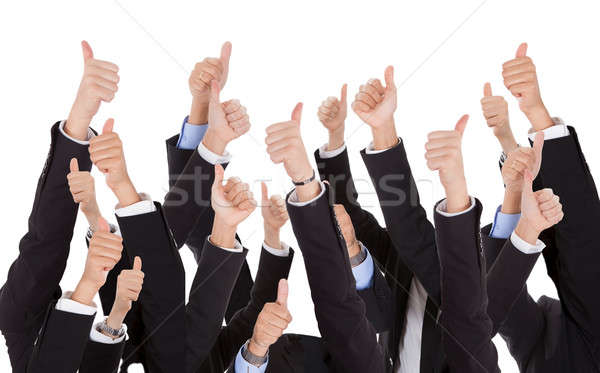 A bunch of raised hands Stock photo © AndreyPopov