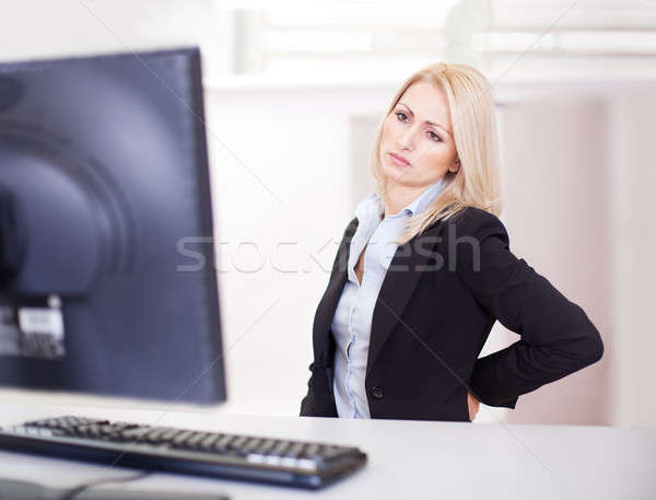 Business women having back pain Stock photo © AndreyPopov