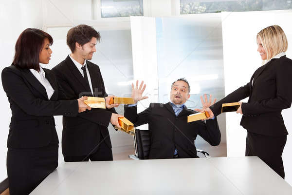 Businessman receiving gold bars Stock photo © AndreyPopov