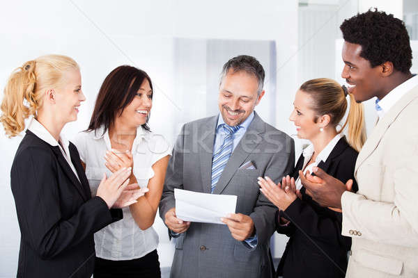 Happy Businesspeople Applauding Businessman Stock photo © AndreyPopov