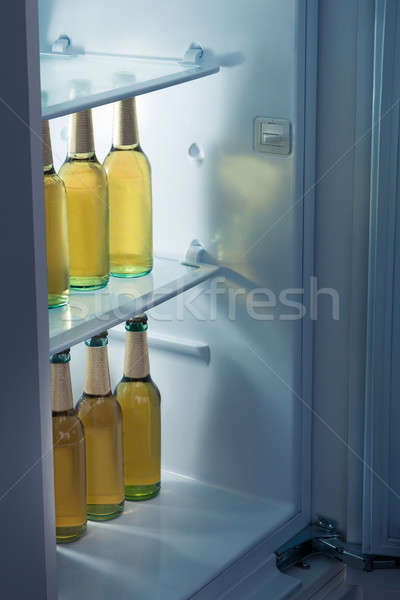 Alcoholic bottles arrange in refrigerator Stock photo © AndreyPopov