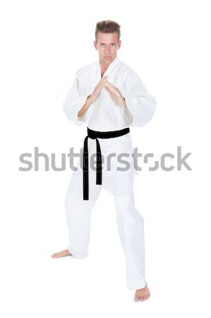 Young Man Practicing Karate Stock photo © AndreyPopov