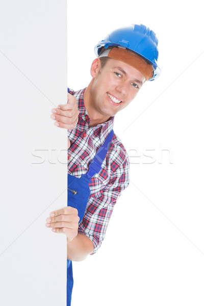 Boldog férfi munkás plakát fehér építkezés Stock fotó © AndreyPopov