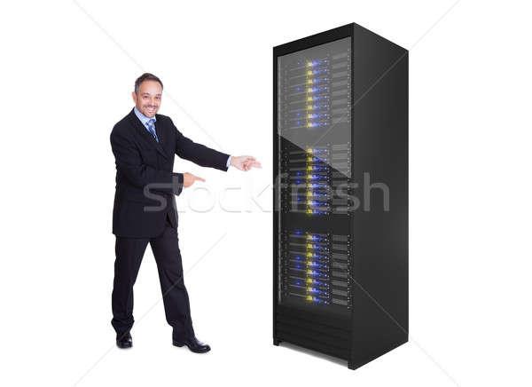 üzletember bemutat szerver rack izolált fehér számítógép Stock fotó © AndreyPopov