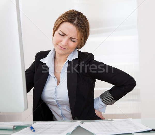 üzletasszony hátfájás üzletasszony tart papír orvosi Stock fotó © AndreyPopov
