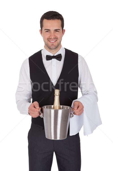 Derűs komornyik tart üveg pezsgő izolált Stock fotó © AndreyPopov