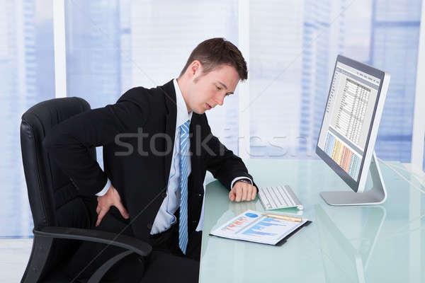 ビジネスマン 腰痛 コンピュータ デスク 小さな ストックフォト © AndreyPopov