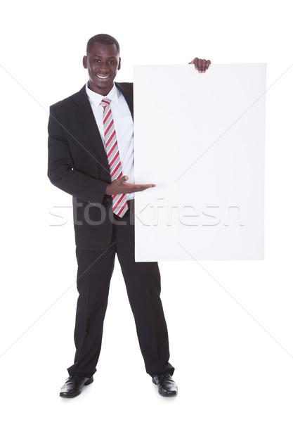 üzletember bemutat plakát portré afrikai kéz Stock fotó © AndreyPopov