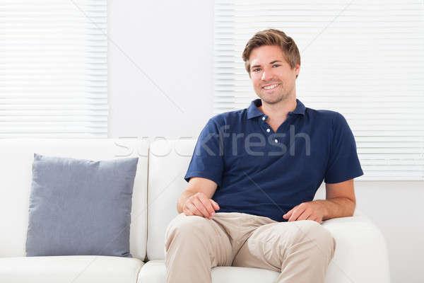 Bell'uomo rilassante divano ritratto bello adulto Foto d'archivio © AndreyPopov