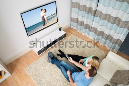 Man Watching Beach View On TV At Home Stock photo © AndreyPopov