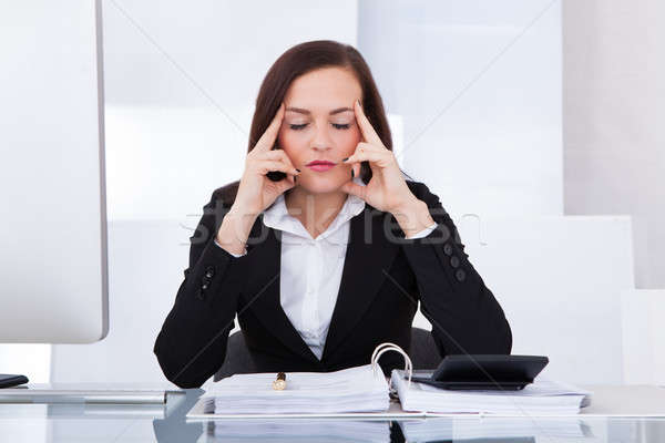 Tensed Businesswoman Calculating Tax Stock photo © AndreyPopov