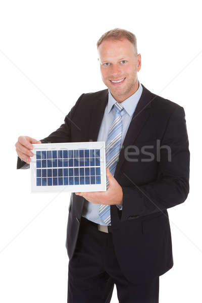 Smiling Businessman Holding Solar Panel Stock photo © AndreyPopov