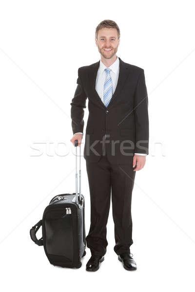 Imprenditore bagaglio piedi bianco ritratto Foto d'archivio © AndreyPopov