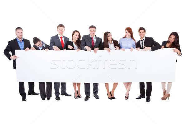 Nagyobb csoport üzletemberek bemutat szalag üres izolált Stock fotó © AndreyPopov
