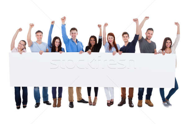 Excited group of diverse people holding banner Stock photo © AndreyPopov