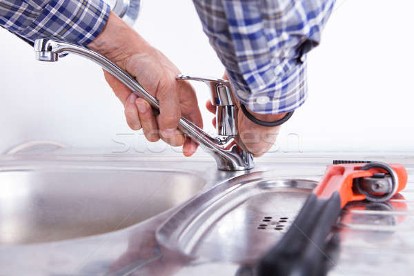 Plumber Fixing Washbasin Stock photo © AndreyPopov