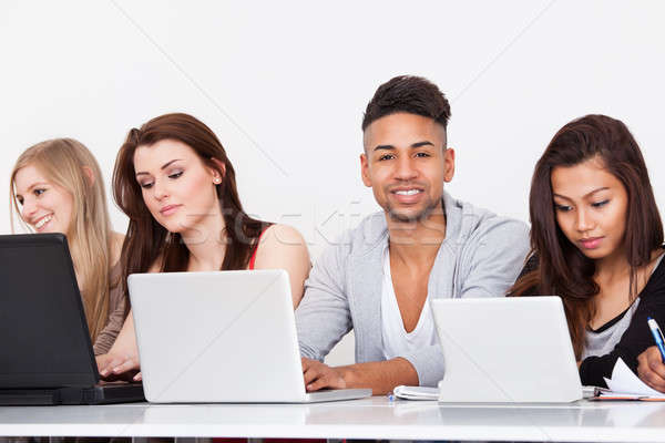 Confident College Student In Computer Class Stock photo © AndreyPopov