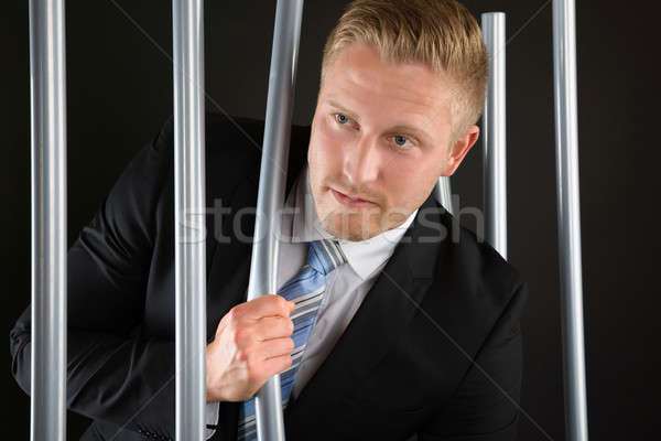 Businessman Escaping From Prison Stock photo © AndreyPopov