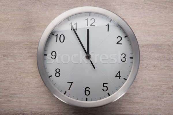 Clock showing five before noon Stock photo © AndreyPopov