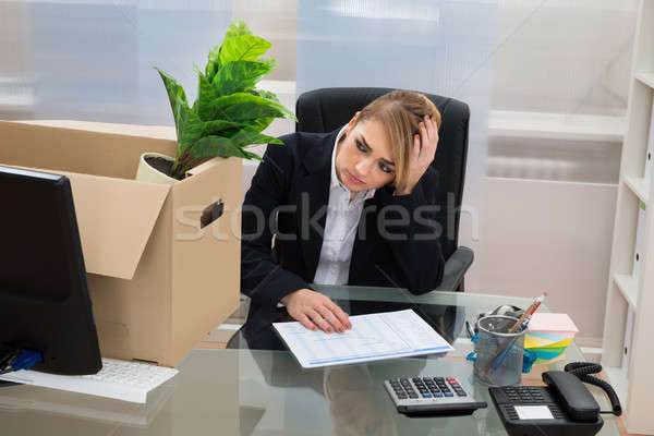 Businesswoman At Desk With Belongings In Box Stock photo © AndreyPopov