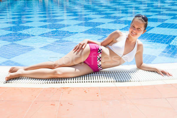 Woman In Swimwear Relaxing At Poolside Stock photo © AndreyPopov