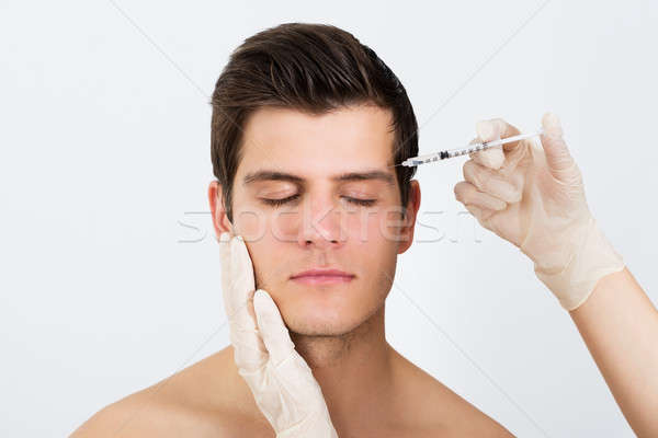 Person Hands Injecting Syringe With Botox Stock photo © AndreyPopov
