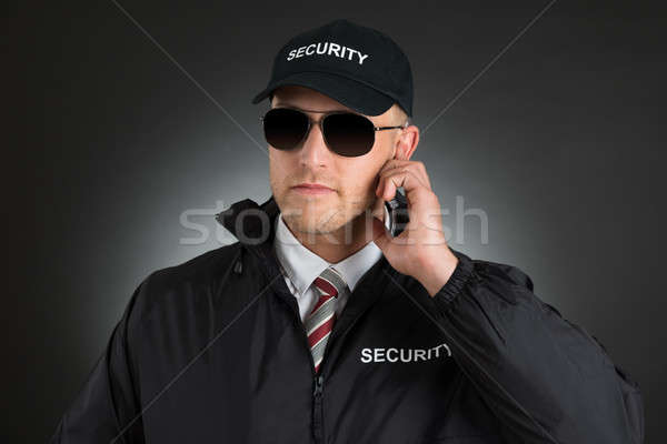 Stock photo: Secret Agent Listening To Earpiece