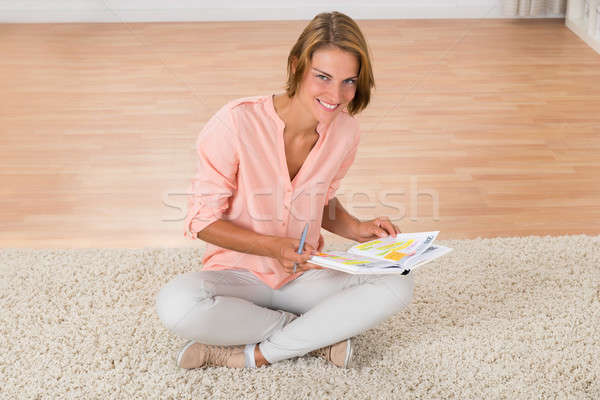 Woman With Diary Sitting On Carpet Stock photo © AndreyPopov