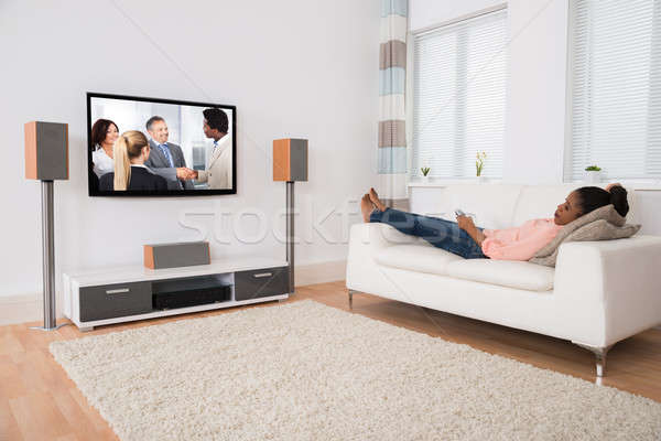Woman Falling Asleep While Watching Television Stock photo © AndreyPopov