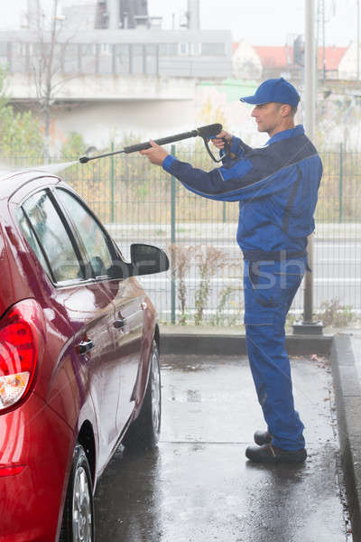 Serviceman With High Pressure Water Jet Washing Car Stock photo © AndreyPopov