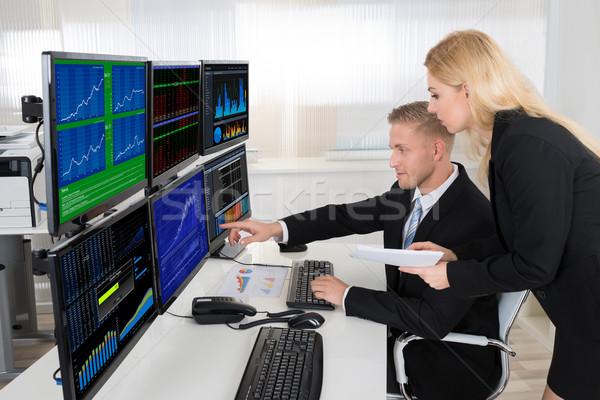 Pénzügyi ellenőrzés számítógép iroda fiatal asztal Stock fotó © AndreyPopov