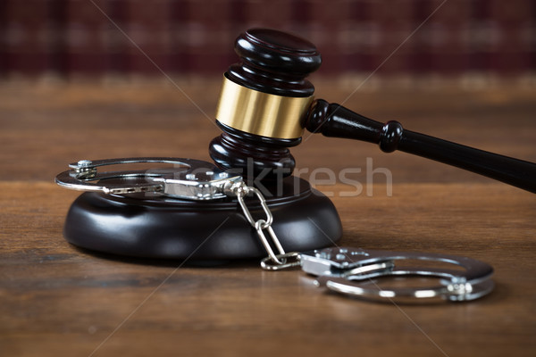 Mallet And Handcuffs On Table In Courtroom Stock photo © AndreyPopov