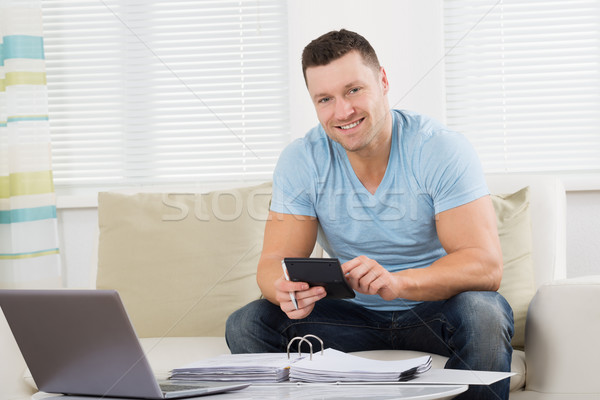 Man Calculating Home Finances At Table Stock photo © AndreyPopov