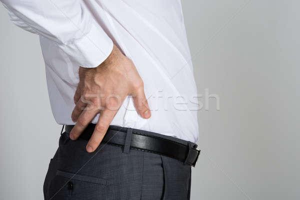 вид сзади бизнесмен страдание назад боль белый Сток-фото © AndreyPopov