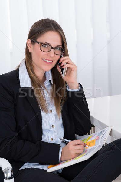 Empresária escrita programar diário retrato feliz Foto stock © AndreyPopov