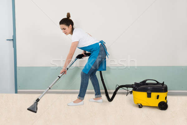 Female Janitor Vacuuming Floor Stock photo © AndreyPopov