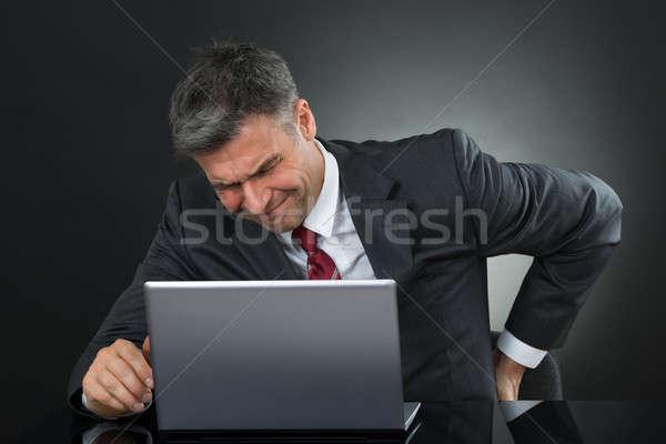 üzletember szenvedés hátfájás dolgozik laptop érett Stock fotó © AndreyPopov