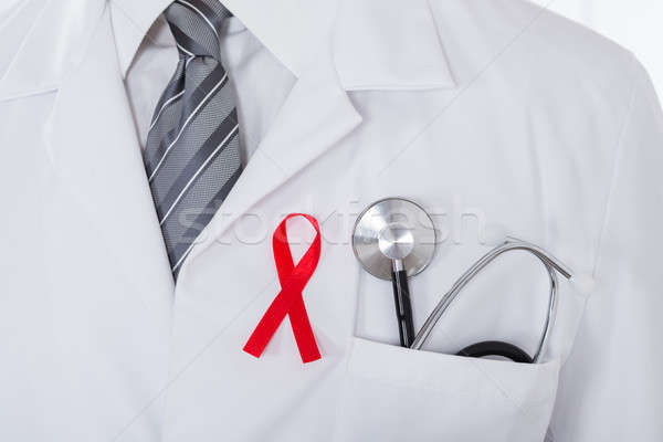 Male Doctor With Stethoscope And Aids Ribbon Stock photo © AndreyPopov