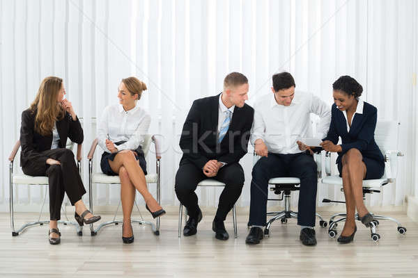Businesspeople Chatting With Each Other Stock photo © AndreyPopov
