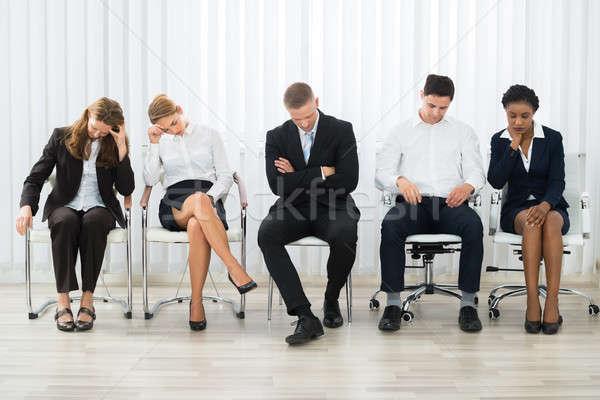 Businesspeople Sleeping In Waiting Room Stock photo © AndreyPopov