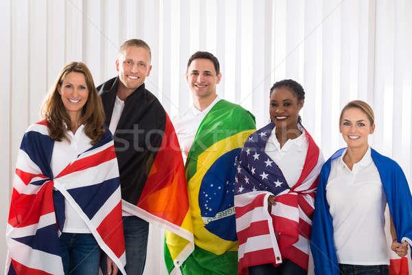 Stok fotoğraf: Arkadaşlar · bayraklar · farklı · grup · mutlu