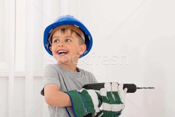 Mały chłopca wiercenie ściany elektryczne wiercenia Zdjęcia stock © AndreyPopov