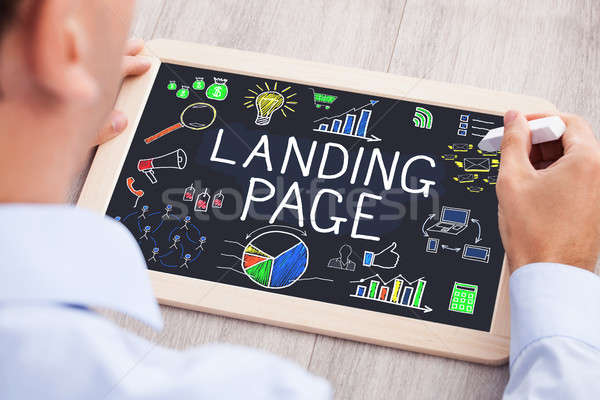 Businessperson Drawing Landing Page Concept On Slate Stock photo © AndreyPopov