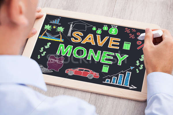 Businessperson Drawing Save Money Concept On Slate Stock photo © AndreyPopov